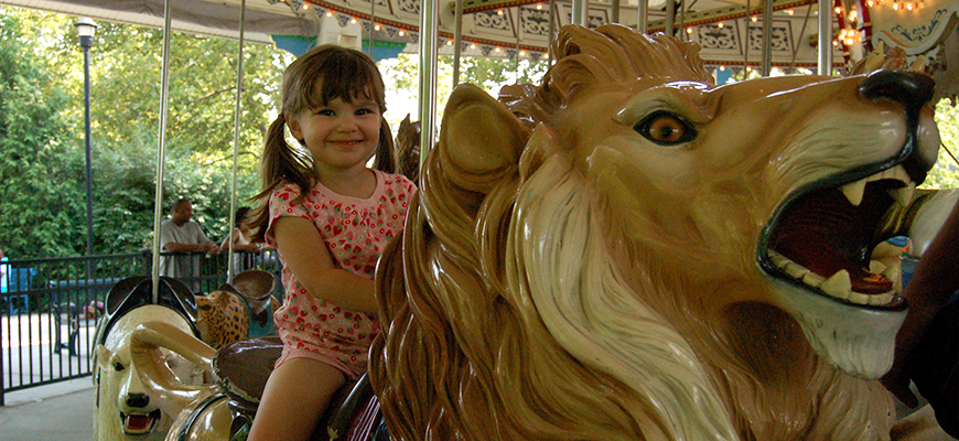 Girl on Carousel at the Louisville Zoo